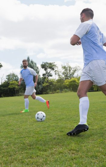 football-players-playing-soccer-in-the-ground-2-TPD87-Q