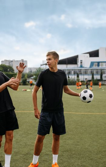soccer-players-training-with-balls-on-the-field-V57-WTXW