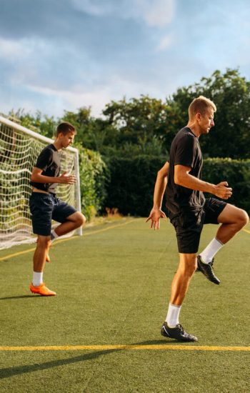 two-male-soccer-players-training-on-the-field-S4-TCF3-J